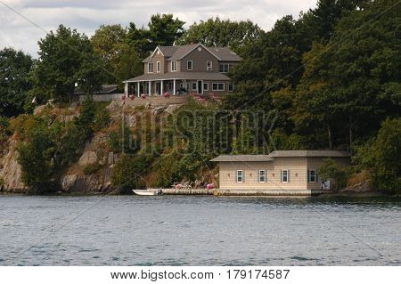 house dock water trees sea way  cottage