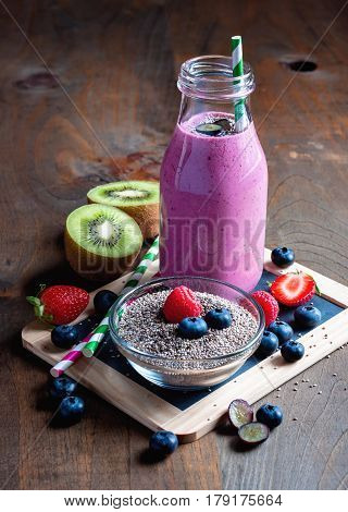 Berry smoothie with yogourt summer detox drink clean eating vegetarian vegan superfood and healthy diet concept selective focus toned image
