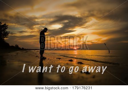 Creative conceptual,I want to go away,word on photo with man alone on the beach during sunset.Calm sea with rippling waves.