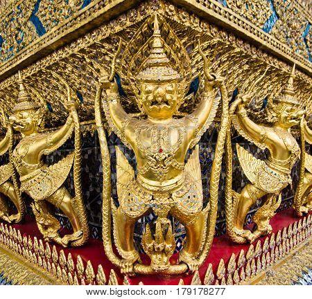 Perspective view of golden religious statue (Statue Garuda) in wat phra kaew temple, Bangkok, Thailand.
