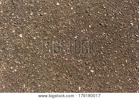 Close up detailed view of coarse asphalt road coating background or texture