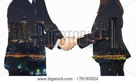 Double exposure of business handshake and city on white background.