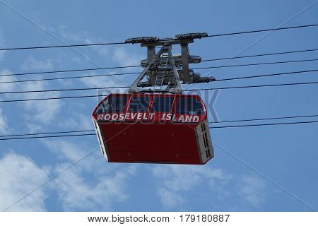NEW YORK - MARCH 30 , 2017: The famous The Roosevelt Island Tramway that spans the East River and connects Roosevelt Island to the Upper East Side of Manhattan