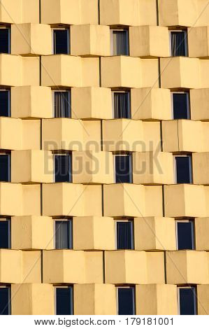 Many Windows on residential yellow building background
