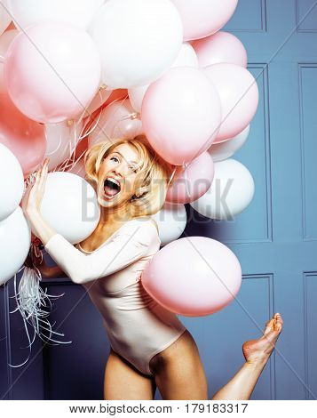 young happy blonde real woman with baloons smiling close up, lifestyle real people concept modern