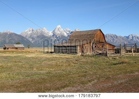 Iconic Mormon Row Barn which is a structure that is a part of Grand Tetons National Parks with the Teton Mountain Range in the background