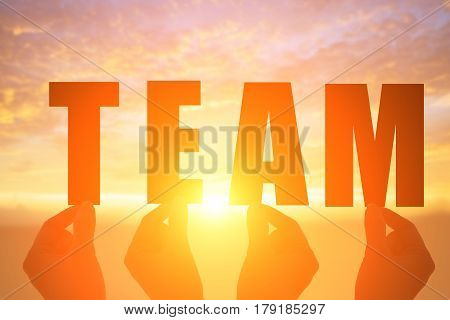 silhouette of hand take team word with sunshine