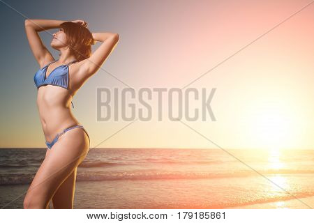 beauty woman wear bikini with sunset and sea