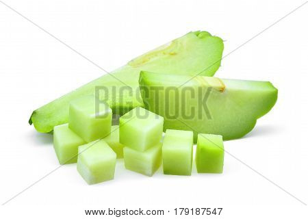 sliecd fresh chayote with cubes isolated on white background