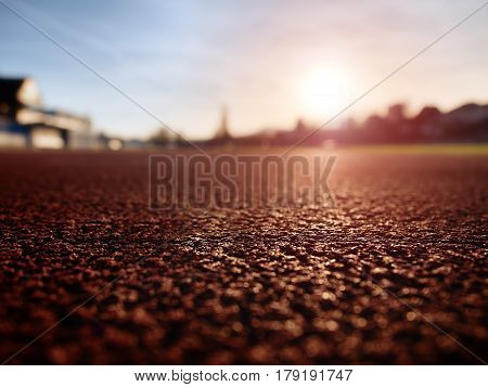 Close Up Red Racetrack Ground On Outdoor Stadium