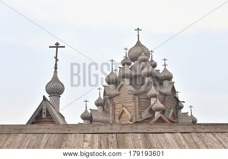 Wooden Church of the Intercession in the style of Russian wooden architecture in the Nevsky Forest Park near St. Petersburg Russia.