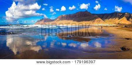 Amazing golden Famara beach over sunset. Lanzarote, Canary islands