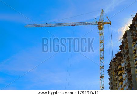 Tower crane at the construction of high-rise building