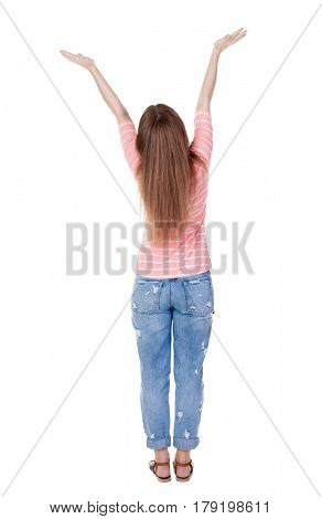 Back view of Beautiful woman in jeans looking at wall and Holds  hand up.  young redhead girl standing. Rear view people. Isolated over white background.