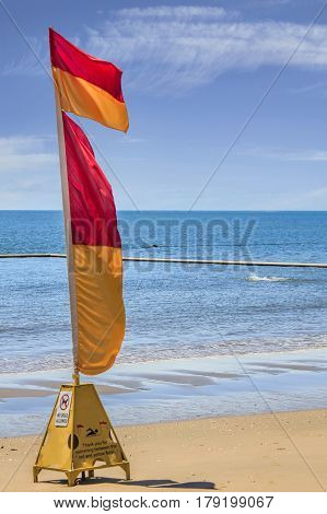 one life saving warning sign flag on the beach