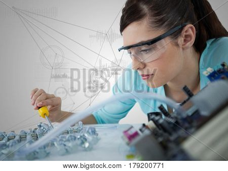 Digital composite of Woman with electronics against white background with graphs