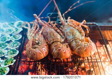 Seafood Lobster dinner on a barbecue grill
