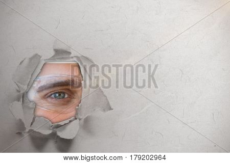 Portrait of happy man wearing protective eyewear against circle hole in paper 3d