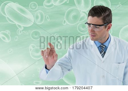 Doctor touching transparent interface against graphic image of red blood cells 3d