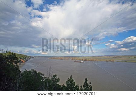 Rainbow Over A Wide Navigable River
