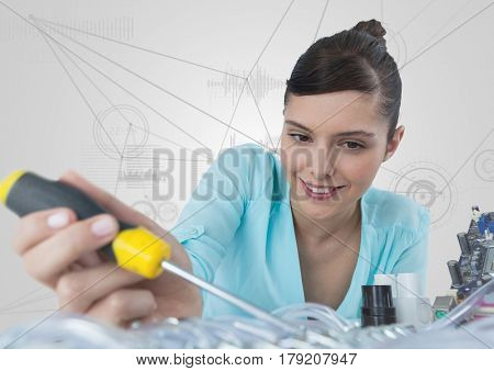 Digital composite of Woman with electronics and screwdriver against white background with graphs