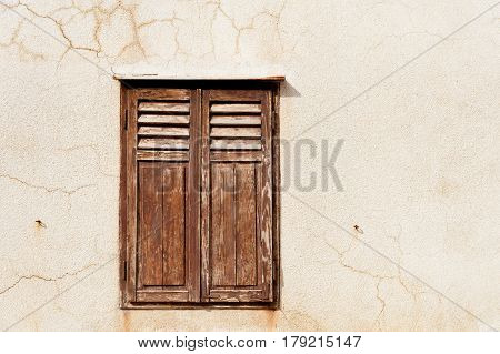 Closed brown shutters of historic old house in Pag town, Croatia