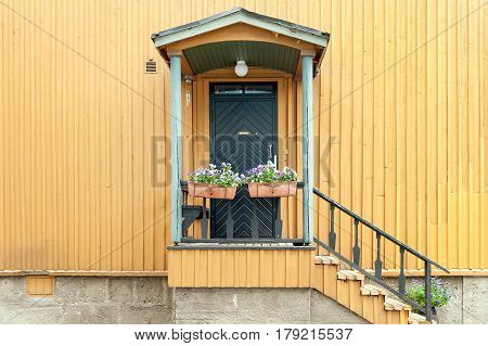 Entrance of traditional wooden house in Helsinki, Finland