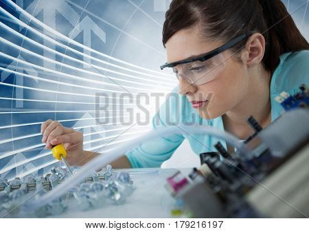 Digital composite of Woman with electronics against blue background with arrows