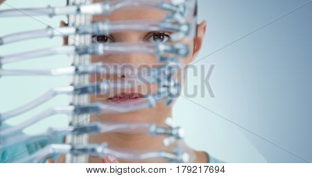 Digital composite of Close up of woman through electronics against blue background