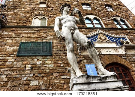 The famous statue David of Michelangelo (reproduction) in front of the entrance of the Palazzo Vecchio, now the City Hall in Piazza della Signoria. Florence, Italy