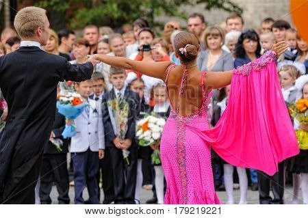 Tyumen, Russia - September 1, 2012: School 43. Primary school children with teachers and parents on the first day of the school year. Feast Day of Knowledge. Couple dances for children