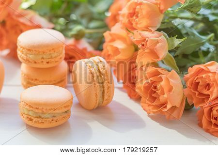 Orange Macaroons And Fresh Little Roses