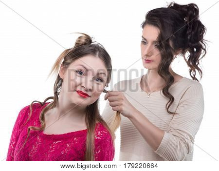 Working hairstylist and smiling woman on white background