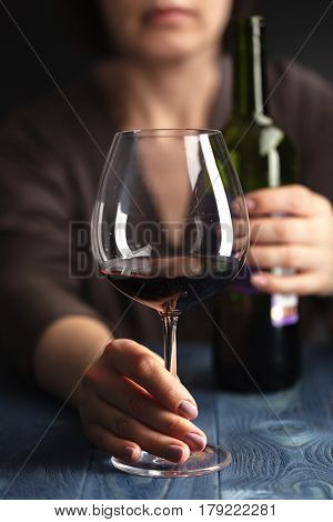Sad And Wasted Alcoholic Woman Sitting At Home Drinking Red Wine Holding Glass,  Alcohol Abuse