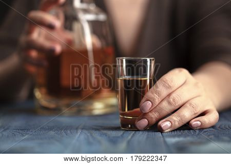 Drunk Woman Holding An Alcoholic Drink, Focused On The Drink