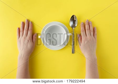 Soup Plate Flat Lay With Female Hands On Yellow