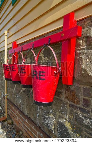 Red fire buckets on the side of the signal box at Instow