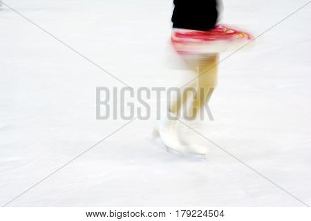 Impression of a Woman Figure Skating doing a spin