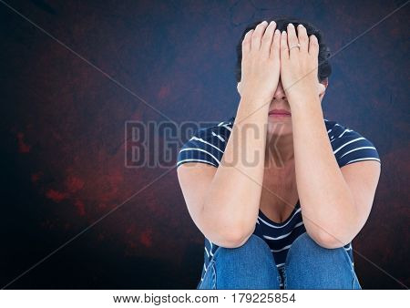 Digital composite of Sad woman with hands over head against blue background