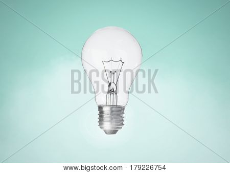Digital composite of Light bulb against turqouise background