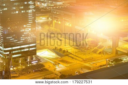 Blurry animated flare against illuminated road in city at night