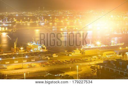 Blurry animated flare against illuminated harbor against cityscape