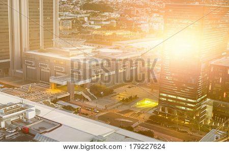 Blurry animated flare against illuminated cityscape at dusk