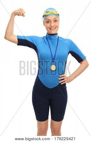 Cheerful female swimmer with a gold medal flexing her biceps isolated on white background