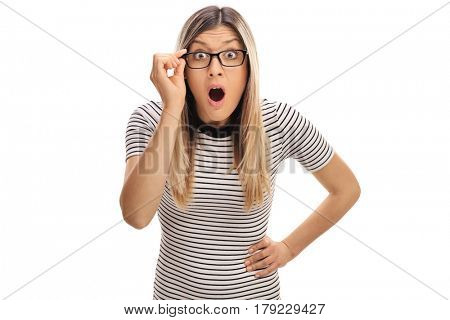 Baffled young woman with eyeglasses looking at the camera isolated on white background