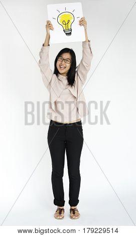 Woman standing doing photoshoot in studio