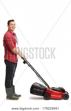 Full length portrait of a gardener with a lawnmower isolated on white background