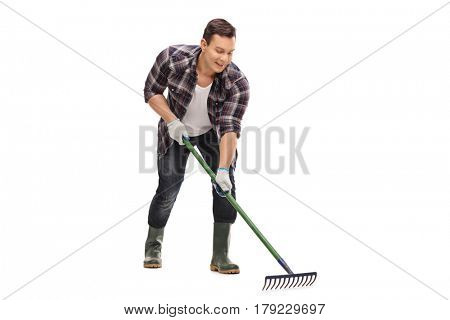 Young gardener using a rake isolated on white background