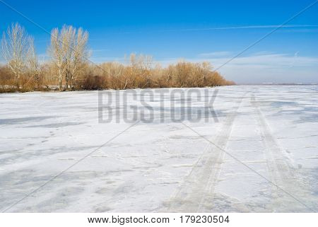 Winter landscape - track on a frozen and snow-covered big Ukranian river Dnepr in Dnepropetrovsk city.