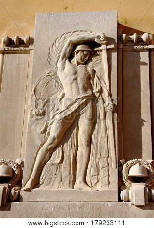 Genoa, Italy. marble bas-relief of the sculptor Francesco Storace who is a soldier sheathing the sword. The bas-relief is the square of the church built in 1745 in honor of Sant 'Antonio in Genoa Boccadasse neighborhood.